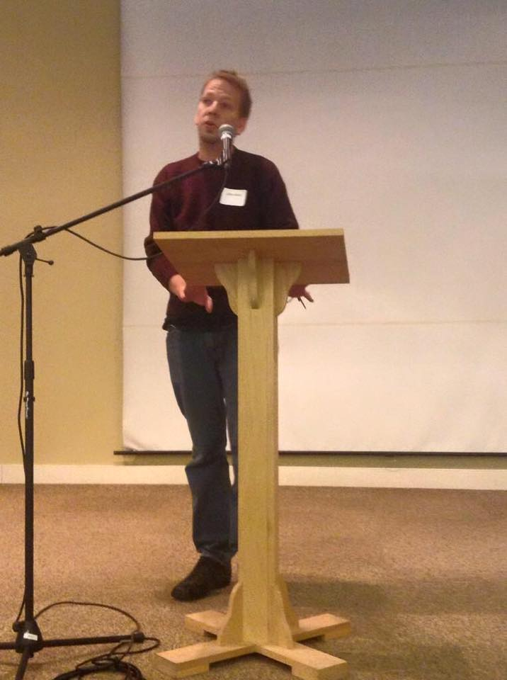 John Most at a poetry conference